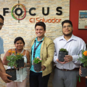 Focus agents at the Las Cascadas location holding plants.